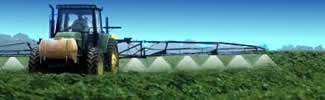 A tractor spraying pesticides to crops on a farm