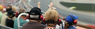 Fans watching stock car - link to For Fans page.