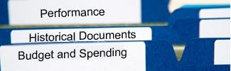 image of three file folders with the words performance, historical documents, and budget and spending