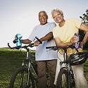 Healthy older couple resting after a bicycle ride.