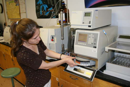 Woman working on fish contaminants in a lab