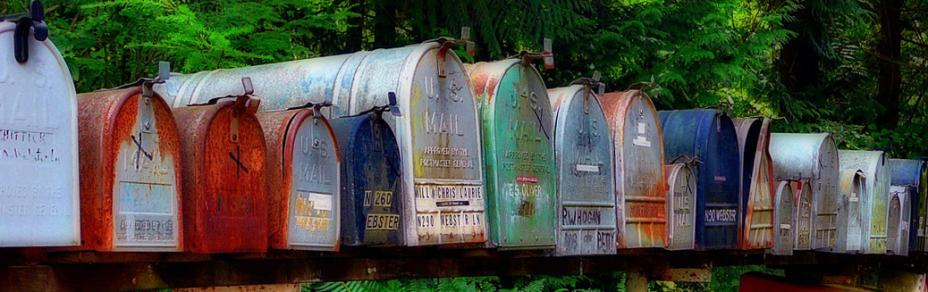 A row of rusty mailboxes