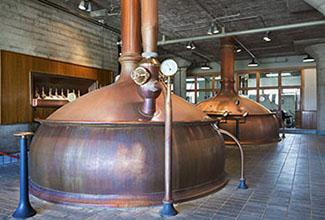 Photo: mash kettles in a brewery