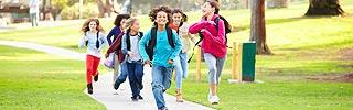 Image of school children running