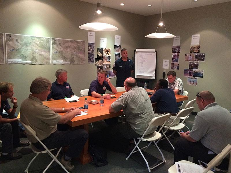 Area Command photo: Area Command staff from EPA and Coast Guard receive updates during a morning briefing