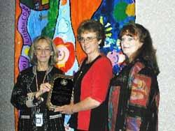 Nola Cooke, Director, Office of Communications and Public Involvement, USEPA Region 8, presents the 2004 Citizens Excellence in Community Involvement Award to Jeri Frye, Co-chair of CCAT and Sara Kitchen, Spokesperson for CCAT.