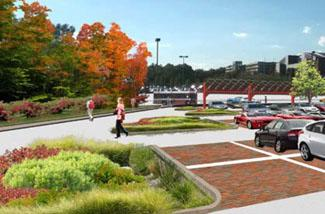 parking lot with rain gardens, bioswales, permeable pavement, solar panels and students walki