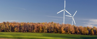 Photo of two windmills in a grassy field