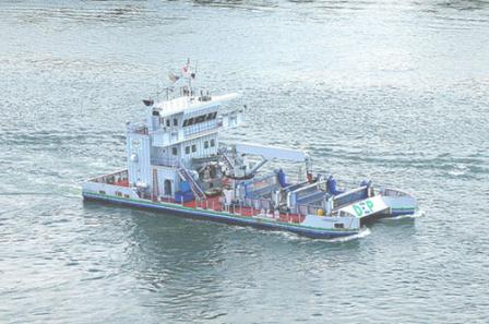 Trash skimming vessel: appears like a blend of a catamaran/double-hulled ship and a barge tug boat.