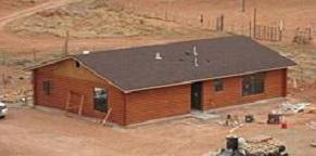 New wood home built to replace contaminated structure