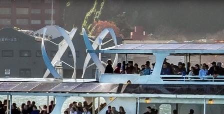 Close up of Alcatraz Ferry showing solar panels and wind generators