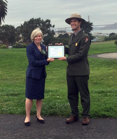 Acting Deputy Regional Administrator Deborah Jordan presents Aaron Roth, Acting Superintendent, Golden Gate Natural Recreation Area, with the Federal Green Challenge Energy Award.