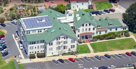 Aerial view of Fort Mason building with solar panels.