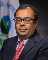 Cecil Rodrigues with the EPA Seal in Background
