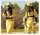Two responders in hazard suits